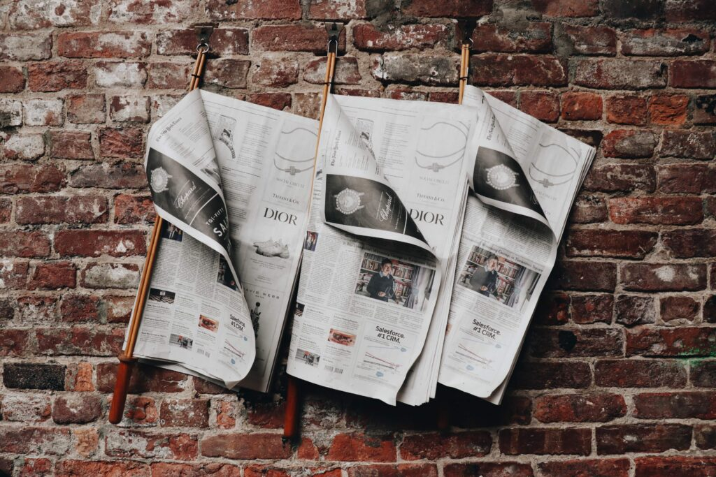 three newspapers